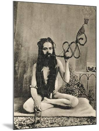 A Sadhu Smoking a Remarkable Pipe, India--Mounted Photographic Print