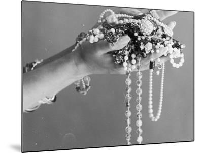 A Pair of Hands Holding All Sorts of Jewellery--Mounted Photographic Print