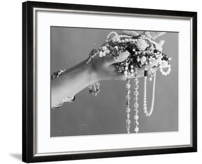 A Pair of Hands Holding All Sorts of Jewellery--Framed Photographic Print