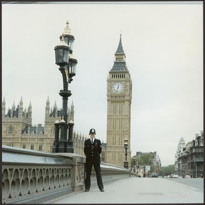 Police Officer on Duty on Westminster Bridge by Big Ben, London. Metropolitan Police--Framed Photographic Print