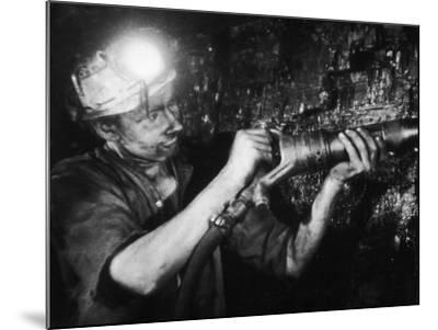 Miner Using an Hydraulic Drill at the Coal-Face, at Cape Bank Hall Pit, Burnley, in Lancashire-Henry Grant-Mounted Photographic Print
