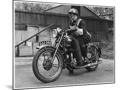 Metropolitan Police Officer on a Triumph Motorcycle During World War II--Mounted Photographic Print