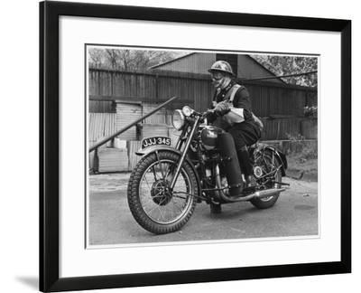 Metropolitan Police Officer on a Triumph Motorcycle During World War II--Framed Photographic Print