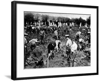 Soldiers Digging Graves for Victims of the Lusitania--Framed Photographic Print