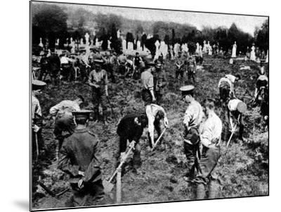 Soldiers Digging Graves for Victims of the Lusitania--Mounted Photographic Print