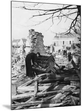 Playing a Piano Amid the Destruction - the Blitz-Robert Hunt-Mounted Photographic Print