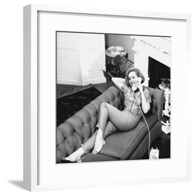 Woman Lying on Sofa, Talking on Phone-George Marks-Framed Photographic Print