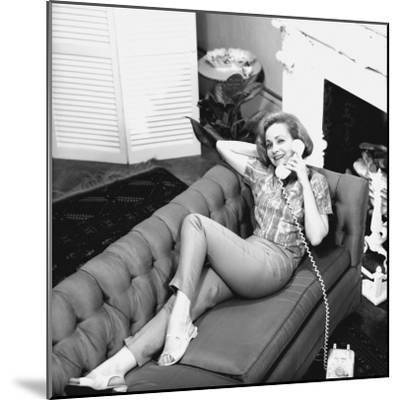 Woman Lying on Sofa, Talking on Phone-George Marks-Mounted Photographic Print