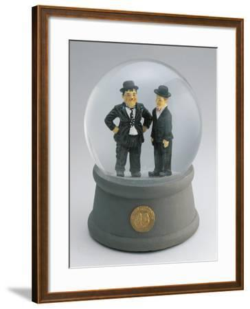 Close-Up of Figurines of Laurel and Hardy in a Snow Globe--Framed Photographic Print