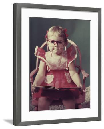 Girl with Eyeglasses Reading Book--Framed Photographic Print