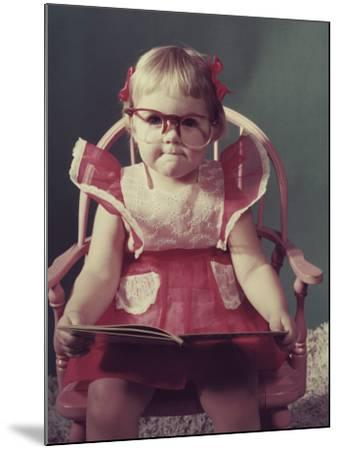 Girl with Eyeglasses Reading Book--Mounted Photographic Print