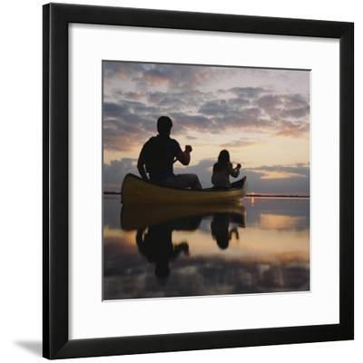 Couple Rowing Canoe in Lake at Sunset-Dennis Hallinan-Framed Photographic Print