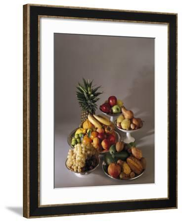 Close-Up of Fruits in Plates and Bowls--Framed Photographic Print