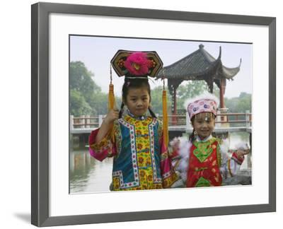 China, Zhejiang Province, Hangzhou, West Lake, Girls Dressed in Qing Dynasty Princess Costume-Keren Su-Framed Photographic Print