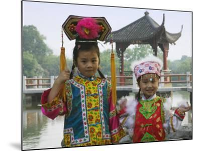 China, Zhejiang Province, Hangzhou, West Lake, Girls Dressed in Qing Dynasty Princess Costume-Keren Su-Mounted Photographic Print