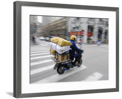 Man with Packages on Scooter--Framed Photographic Print