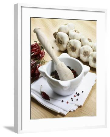 Close-Up of a Mortar and Pestle with Garlic--Framed Photographic Print