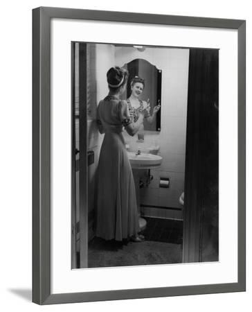 Young Woman Brushing Teeth in Bathroom-George Marks-Framed Photographic Print