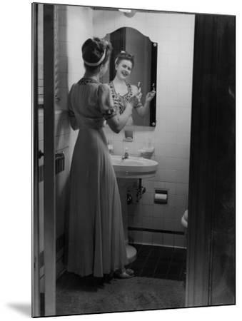 Young Woman Brushing Teeth in Bathroom-George Marks-Mounted Photographic Print