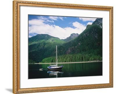 Detail of a Sailboat on Water Near Mountains-Jeff Foott-Framed Photographic Print