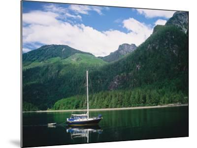 Detail of a Sailboat on Water Near Mountains-Jeff Foott-Mounted Photographic Print