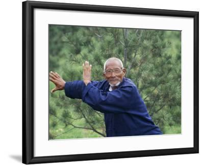 China, Shaanxi Province, Xian, Elderly Man Doing Taichi-Keren Su-Framed Photographic Print