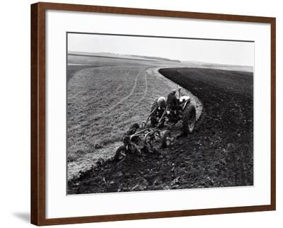 Man on Tractor Dragging Plough Through Vast Field, Rear View-H^ Armstrong Roberts-Framed Photographic Print
