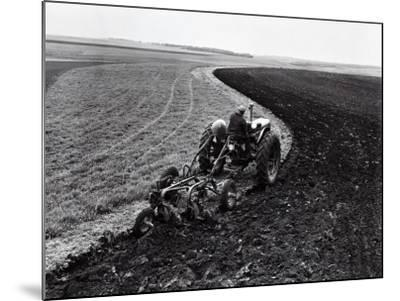 Man on Tractor Dragging Plough Through Vast Field, Rear View-H^ Armstrong Roberts-Mounted Photographic Print