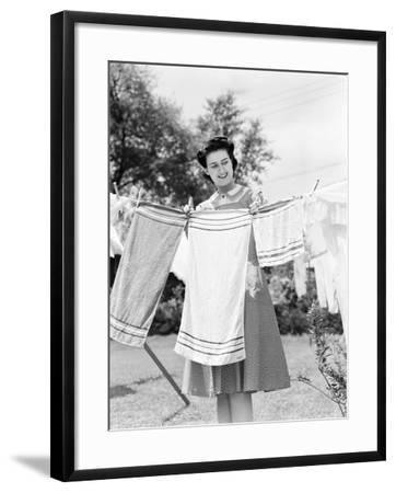 Woman Wearing a White Collar Poka Dot Cotton Dress While Pinning a Towel on a Clothes Line-H^ Armstrong Roberts-Framed Photographic Print