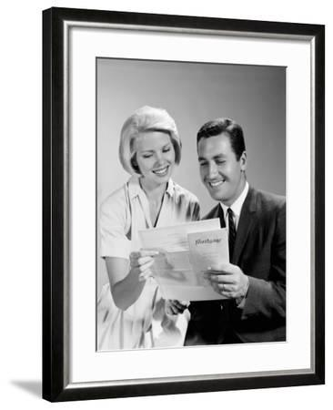 Husband and Wife Homeowners Looking at Mortgage and Smiling-H^ Armstrong Roberts-Framed Photographic Print