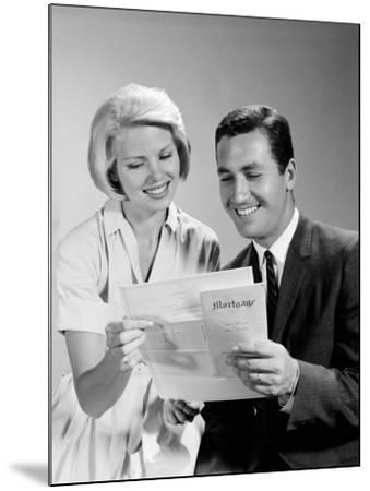 Husband and Wife Homeowners Looking at Mortgage and Smiling-H^ Armstrong Roberts-Mounted Photographic Print