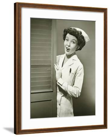Nurse Peeping Trough Opened Doors-George Marks-Framed Photographic Print