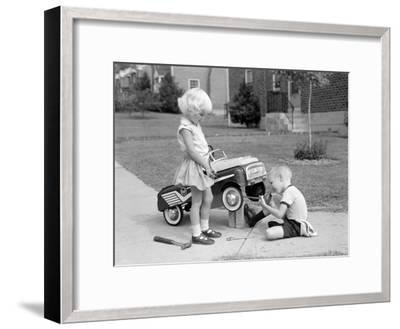 Children on Suburban Sidewalk, Boy Playing As Mechanic, Oiling Toy Pedal Car-H^ Armstrong Roberts-Framed Photographic Print