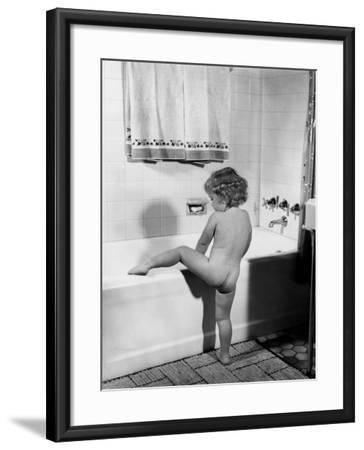 Baby Girl Climbing Into Bath Tub-H^ Armstrong Roberts-Framed Photographic Print