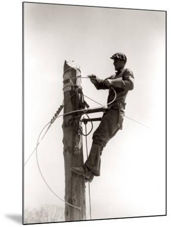 Working Atop Utility Pole-H^ Armstrong Roberts-Mounted Photographic Print