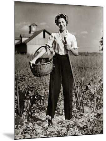 Woman Standing in Cornfield With Hoe and Basket-George Marks-Mounted Photographic Print