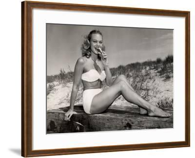 Woman Eating a Hot-Dog at the Beach-George Marks-Framed Photographic Print