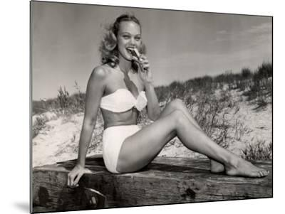 Woman Eating a Hot-Dog at the Beach-George Marks-Mounted Photographic Print
