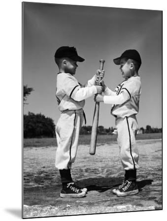 Two Boys in Little League Uniforms, Facing Each Other, Holding Baseball Bat-H^ Armstrong Roberts-Mounted Photographic Print