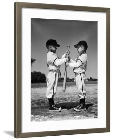 Two Boys in Little League Uniforms, Facing Each Other, Holding Baseball Bat-H^ Armstrong Roberts-Framed Photographic Print