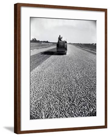 Highway Construction Worker Operating Heavy Machinery on Loose Gravel Road-H^ Armstrong Roberts-Framed Photographic Print