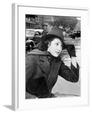 Woman Out in Traffic During a Rain Storm Holding the Brim of Her Hat-H^ Armstrong Roberts-Framed Photographic Print