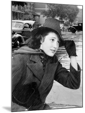 Woman Out in Traffic During a Rain Storm Holding the Brim of Her Hat-H^ Armstrong Roberts-Mounted Photographic Print