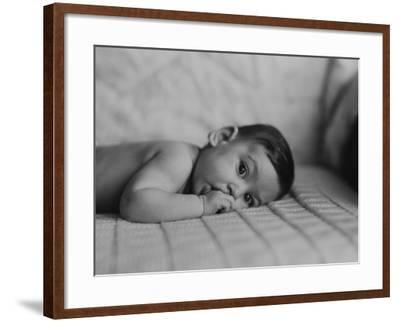 Portrait of Baby Boy (6-11 Months) Lying on Front With Fingers in Mouth-George Marks-Framed Photographic Print