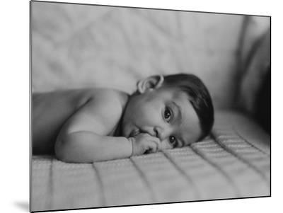 Portrait of Baby Boy (6-11 Months) Lying on Front With Fingers in Mouth-George Marks-Mounted Photographic Print