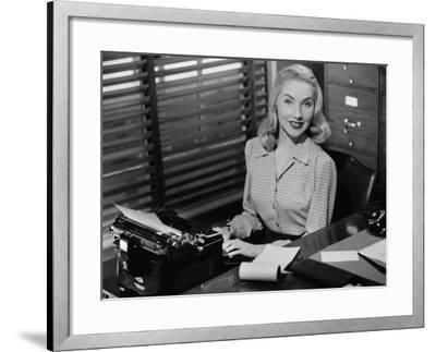 Secretary Sitting at Manual Typewriter, Portrait-George Marks-Framed Photographic Print