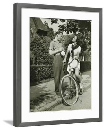Young Couple Talking on Street, Woman on Bicycle-George Marks-Framed Photographic Print