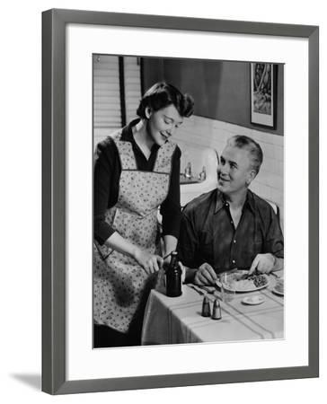 Woman Opening Beer Bottle For Man Eating Dinner-George Marks-Framed Photographic Print