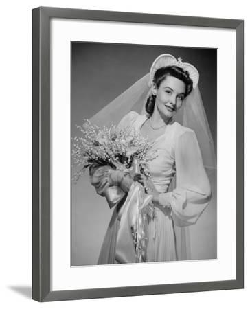 Bride Holding Bouquet, Posing in Studio, Portrait-George Marks-Framed Photographic Print