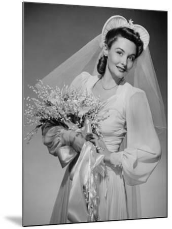 Bride Holding Bouquet, Posing in Studio, Portrait-George Marks-Mounted Photographic Print